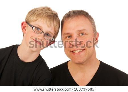 Portrait father and son in black in the studio - stock photo