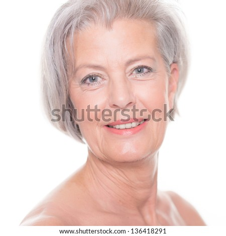 Portrait from a senior woman in front of white background - stock photo
