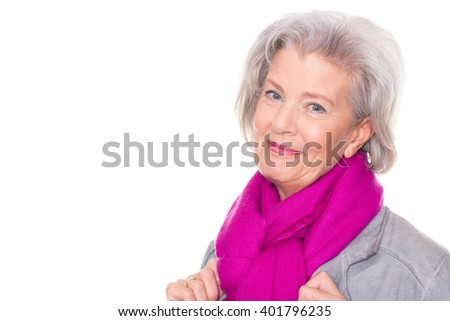 Portrait from a smiling senior woman in front of white background