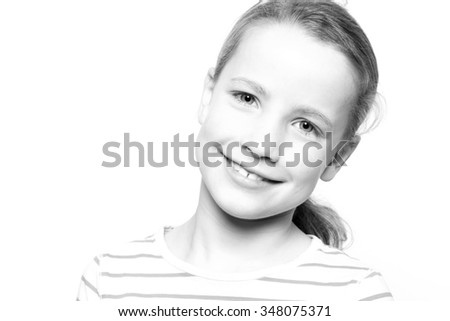 Portrait from a young girl in front of white background - stock photo