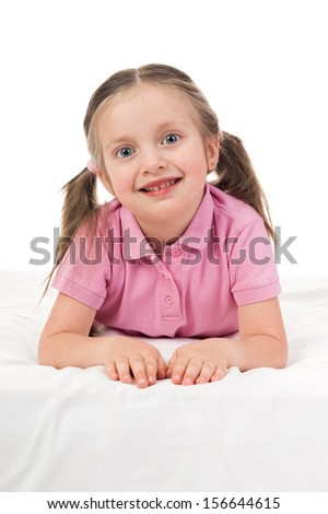 portrait girl in pink dress in bed - stock photo