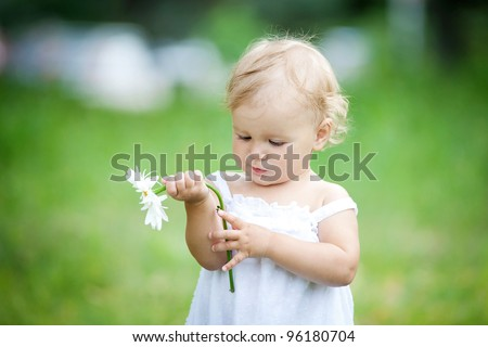 Portrait girl with a camomile - stock photo