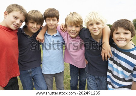 Portrait group of boys in park - stock photo