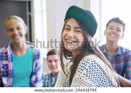 Portrait  group of teenagers in school - stock photo