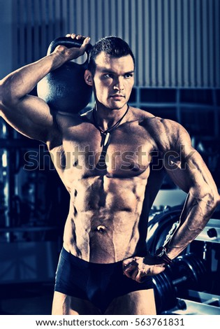 portrait guy - bodybuilder, with weight, in gym, blue, violet tone
