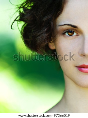 Portrait half of beautiful polish girl close up on green background. - stock photo