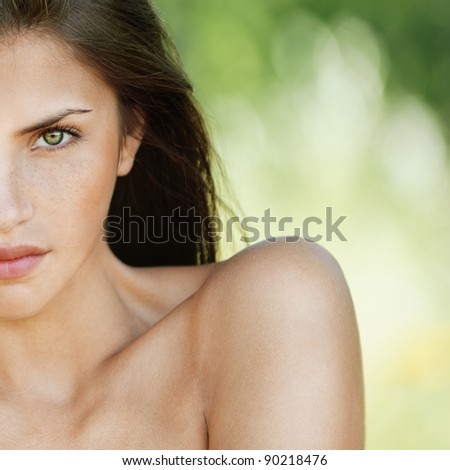 portrait half of face young charming woman romantic sexy stripped serious background summer green park - stock photo