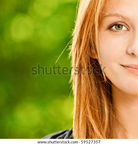 Portrait half of young beautiful woman against summer garden. - stock photo