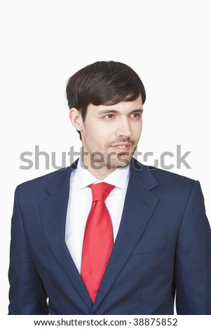 portrait handsome business executive in suit isolated on white - clipping path