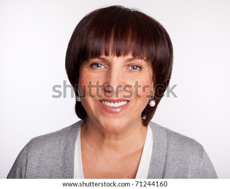 Portrait happiness mature woman, looking at camera - stock photo