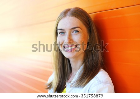 Portrait happy beautiful smiling woman closeup over colorful background - stock photo