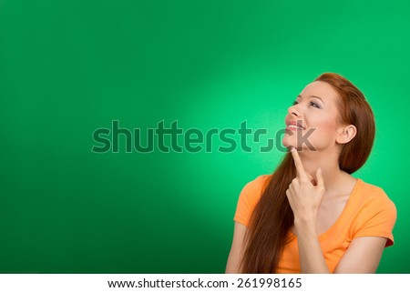 Portrait happy beautiful woman thinking looking up isolated green background with copy space. Human face expressions, emotions, feelings, body language, perception - stock photo