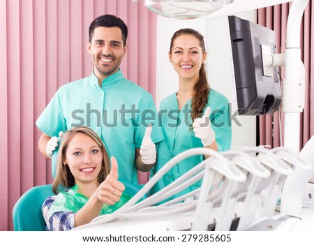 Portrait happy doctor, assistant and smiling patient at surgery office - stock photo