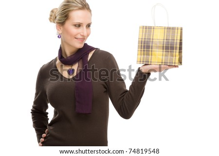 Portrait happy fashion woman in designer clothes with shopping bag