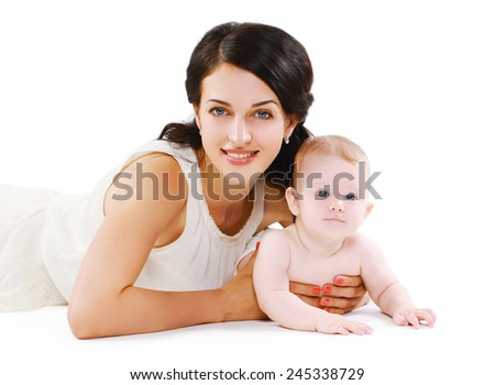 Portrait happy mother and baby lying together - stock photo