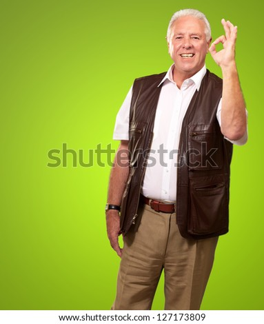 Portrait Happy Old Man On Green Background - stock photo