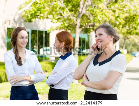Portrait happy, smiling corporate worker talking on mobile phone, isolated background company female employee having conversation outside office on sunny summer day. Positive face expression, emotions - stock photo