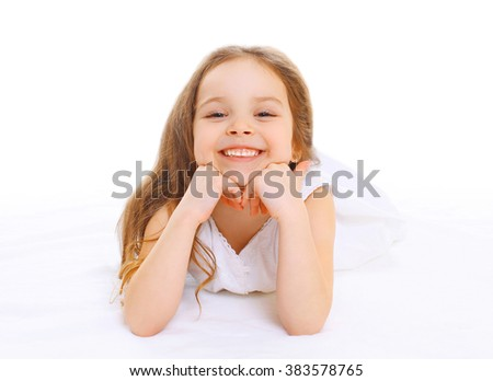 Portrait happy smiling little cute girl child lying on white background - stock photo