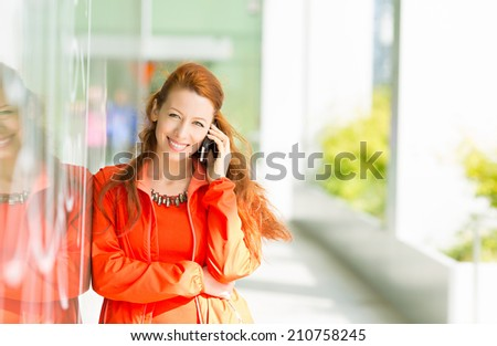 Portrait happy smiling woman talking on mobile cell phone standing outdoor her university. Business woman having conversation on cellphone isolated outside office background. Communication concept - stock photo