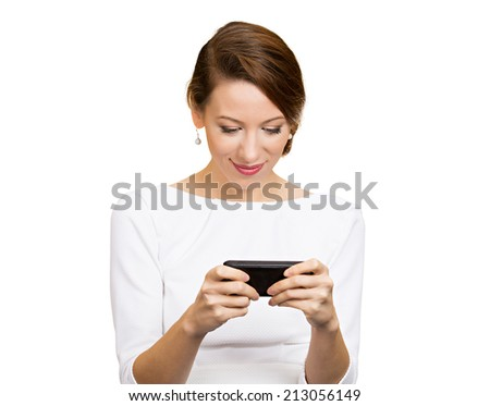 Portrait happy, smiling woman texting on her smart phone, isolated white background. Communication concept. Positive facial expressions, emotion, feelings, good news. Internet, phone addiction - stock photo