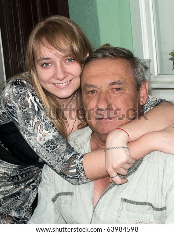 Portrait happy the grandfather and granddaughter - stock photo