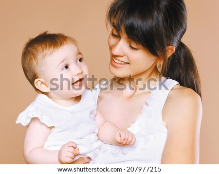 Portrait happy young mom and child - stock photo