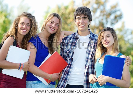 Portrait happy young students in park,Italy - stock photo