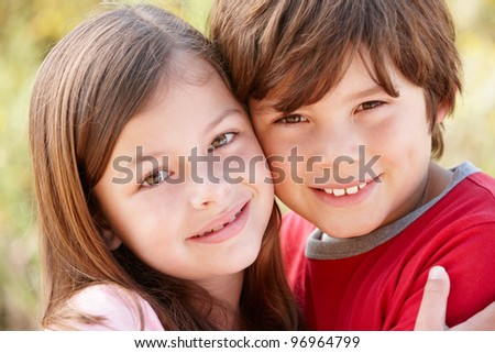 Portrait hispanic brother and sister outdoors - stock photo