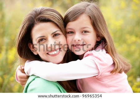 Portrait Hispanic mother and daughter