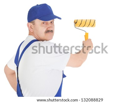 Portrait house painter is painting invisible wall, isolated on white background - stock photo