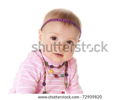 Portrait if beautiful baby girl in pink sweater isolated on white background - stock photo