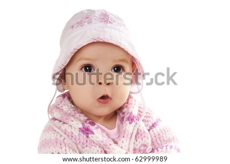 Portrait if pretty baby girl i pink sweater isolated on white background - stock photo