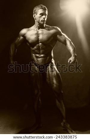 Portrait in full growth bodybuilder. Looking away - stock photo