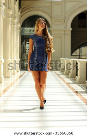 Portrait in full growth - the attractive young girl in a sexual dress