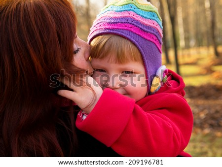 Portrait in nature mom and baby in autumn - stock photo