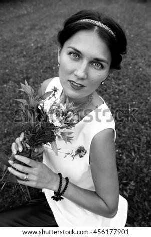 portrait in nature with a bouquet