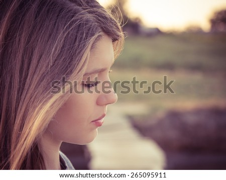 Portrait in profile of a teenage girl close up - stock photo