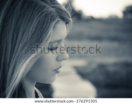 Portrait in profile of a teenage girl close up. Black and white - stock photo