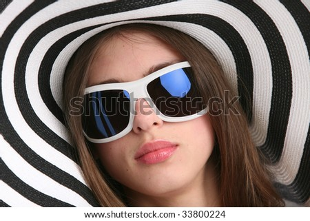 portrait in striped hat and sunglasses - stock photo