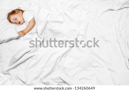 portrait infant lying on the bed - stock photo
