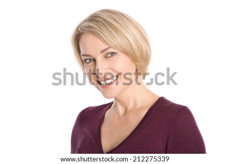 Portrait: isolated face of a smiling attractive older blond woman. - stock photo