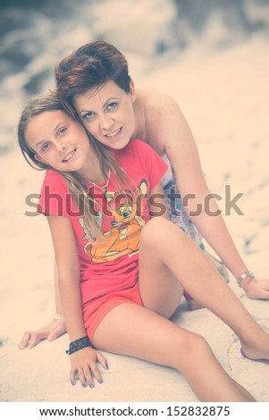 Portrait italian mother and daughter - stock photo