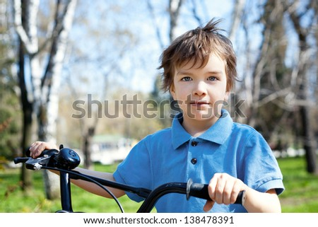 portrait kid with bicycle, outdoor - stock photo