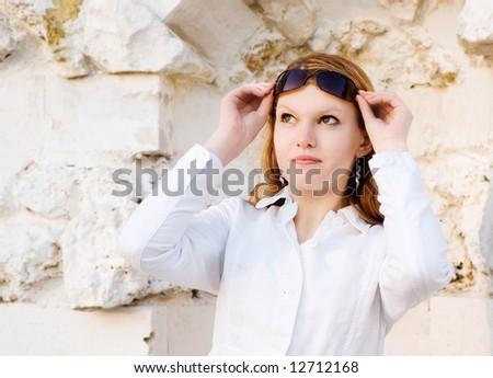 Portrait lady taking sun glasses off - stock photo