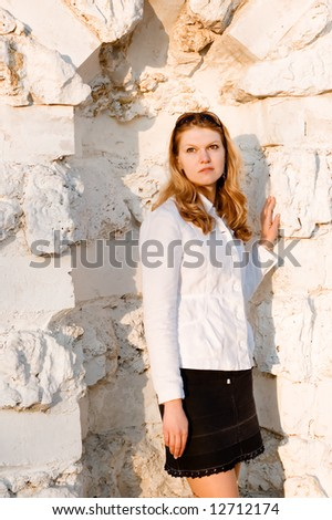 Portrait lady with sun glasses at limestone wall - stock photo