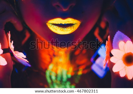 portrait, lips and hands in the neon light, glowing flowers