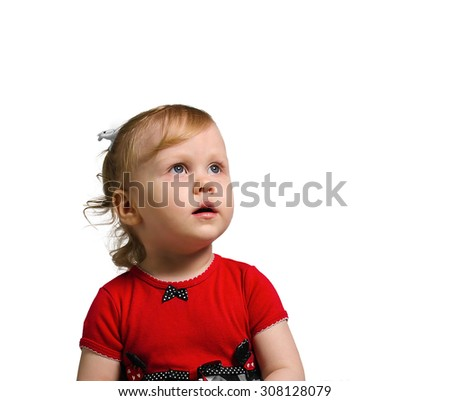 portrait little girl in a red dress portrait, which oversees something, mouth open