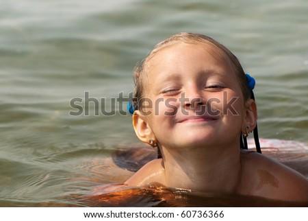 Portrait little girl on sea - stock photo