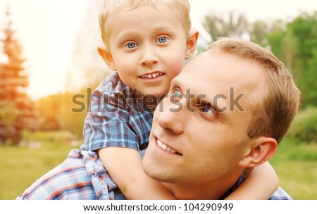 Portrait little son and his father at the outdoor - stock photo