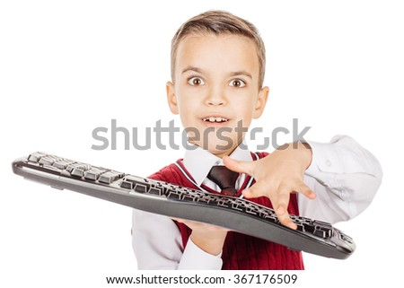 Portrait little student boy with keyboard isolated on white studio background. education, school and future technology concept - stock photo